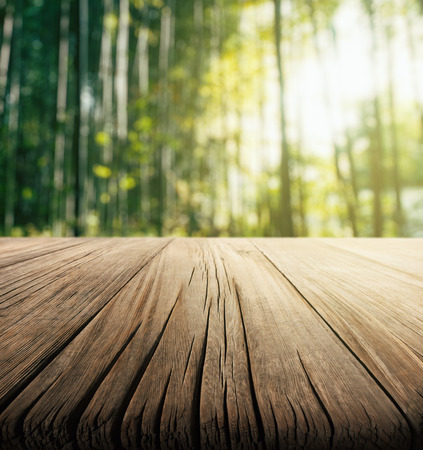 Empty wooden table with bamboo forest background