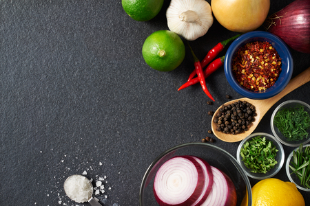 Spices and food ingredients on slate background with copy space Zdjęcie Seryjne - 52376699