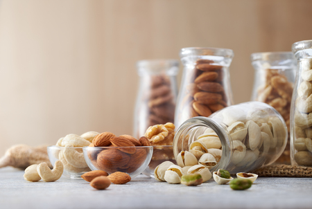 Healthy nuts on wooden background