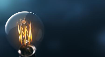 edison: Glowing edison light bulb on blue background