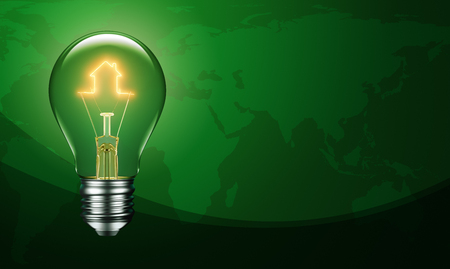 Light bulb with filament forming a house icon on green earth background Stock Photo