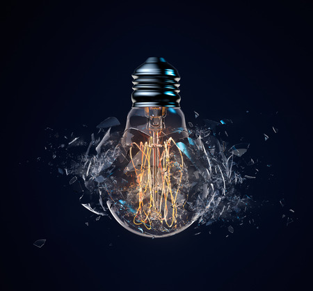 Exploding light bulb on a dark blue background
