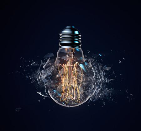 energia electrica: La explosión de la bombilla de luz sobre un fondo azul oscuro Foto de archivo