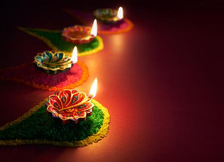 lit lamp: Colorful clay diya lamps lit during diwali celebration
