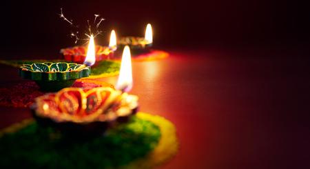 red oil lamp: Colorful clay diya lamps lit during diwali celebration