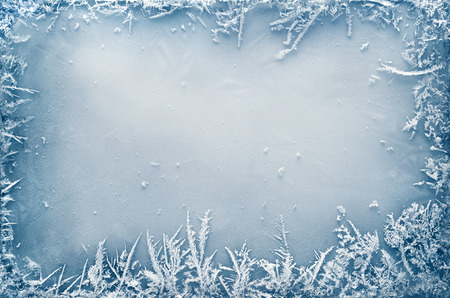 ice crystal: Frost crystal border on ice - Christmas background Stock Photo