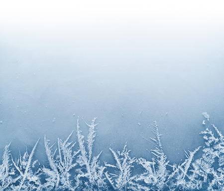 Frost crystal border on ice - Christmas background Standard-Bild