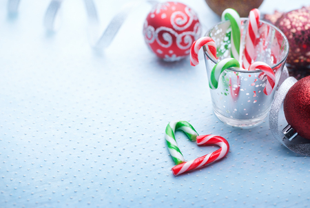 peppermint candy: Christmas decoration with peppermint candy canes on blue background