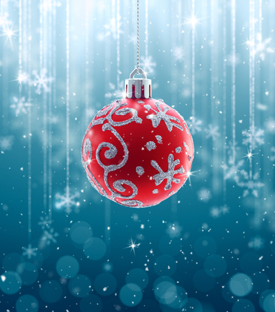 hang up: Christmas Baubles and fallen defocused snowflakes on blue background