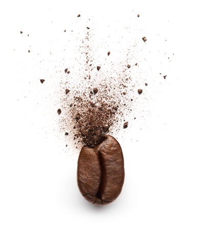 Coffee powder burst from coffee bean isolated on white background Banque d'images