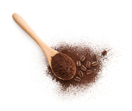Wooden Spoon filled with coffee powder isolated on white background