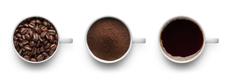 Coffee beans, ground coffee and cup of black coffee over white background