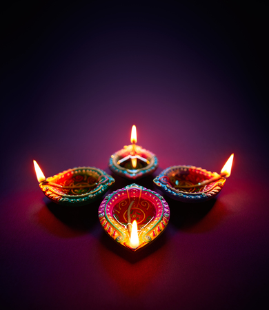 Colorful clay diya lamps lit during diwali celebration Banco de Imagens - 81019073