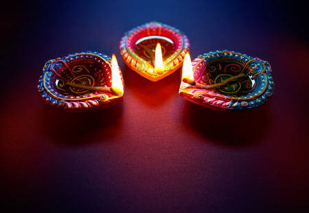 Colorful clay diya lamps lit during diwali celebration Zdjęcie Seryjne - 81144581