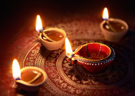 Happy Diwali - Diya lamps lit during diwali celebration 스톡 콘텐츠