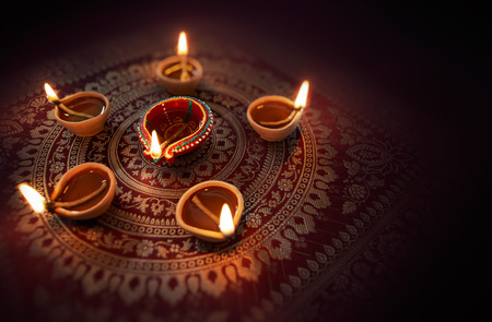 Happy Diwali - Diya lamps lit during diwali celebration Stock Photo