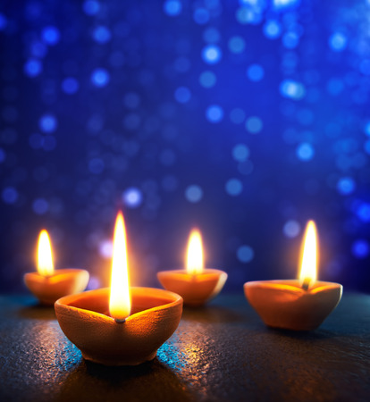 oil lamp: Happy Diwali - Diya lamps lit during diwali celebration Stock Photo