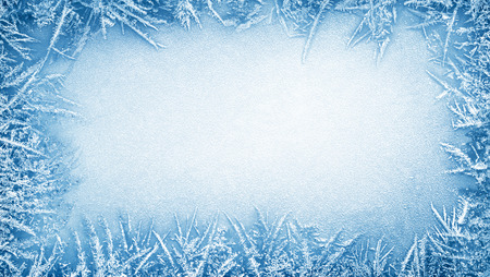 Frost crystal border on ice - Christmas background Stock Photo
