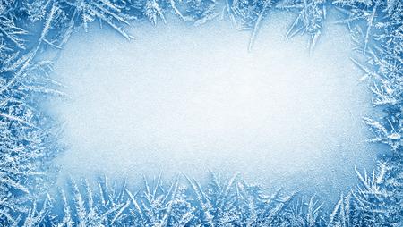 Frost crystal border on ice - Christmas background Standard-Bild