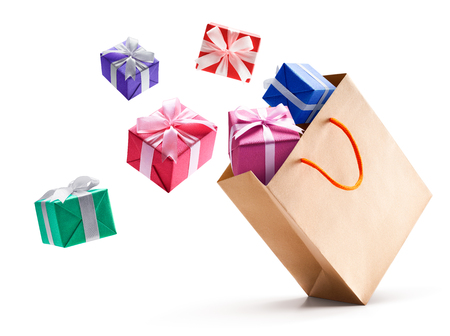 Gift boxes pop out from paper bag isolated on white background