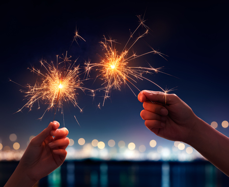 Couple holding a burning sparklers