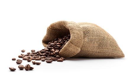 Coffee beans spilled out from burlap sack isolated on white background