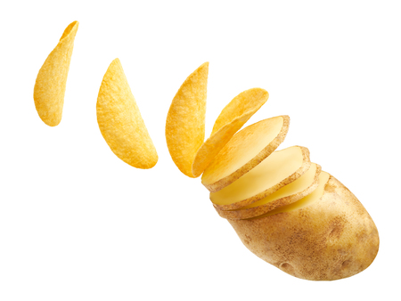 Potato slices turning into chips isolated on white background
