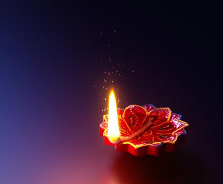 Diya lamp lit during diwali celebration