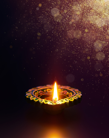 Diwali celebration - Diya lamp with golden glitter