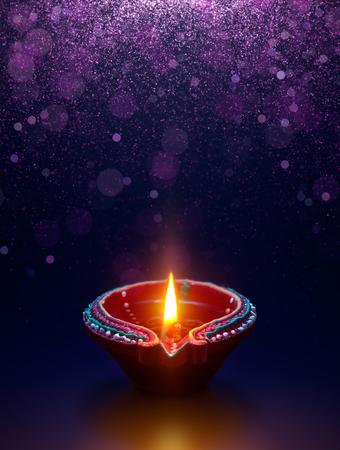 Diwali celebration - Diya lamp with glitter light background