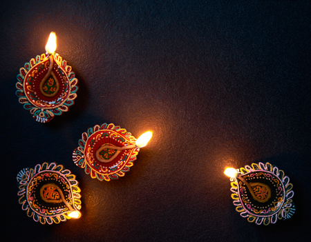 Happy Diwali - Colorful Diya lamp on floor