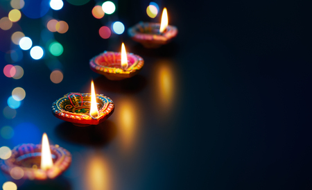 Colorful Diya lamps with bokeh lights background
