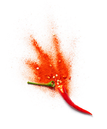 Chili powder bursting out of a red chili pepper Stok Fotoğraf