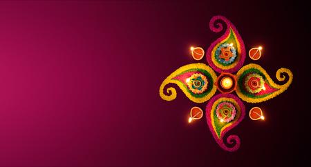 Diwali celebration - Diya oil lamps lit on colorful rangoli Foto de archivo
