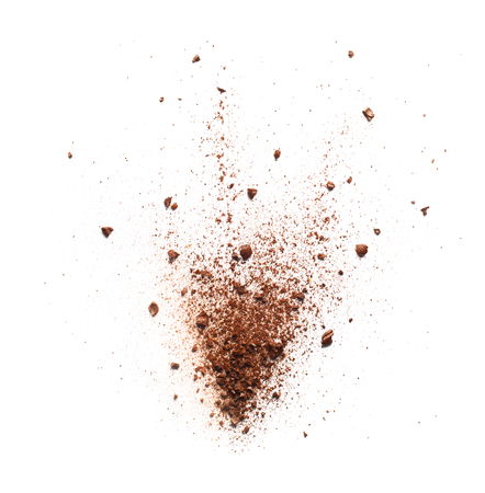 Coffee powder burst over white background Foto de archivo