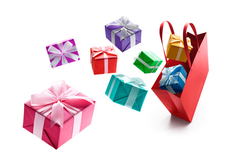 Gift boxes pop out from red shopping bag