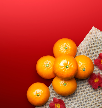 Chinese New Year - Mandarin oranges on red background