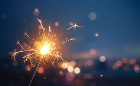 Sparkler with blurred busy city light background Stock Photo