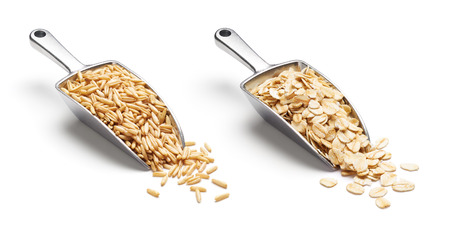 Oat groats and rolled oats on metal scoop