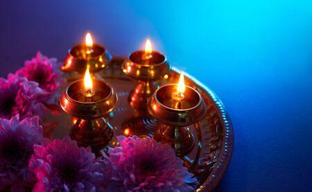 Happy Diwali - Oil lamps lit during diwali celebration