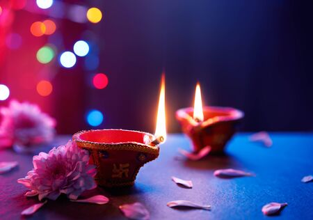 Happy Diwali - Diya lamps on floor with bokeh light