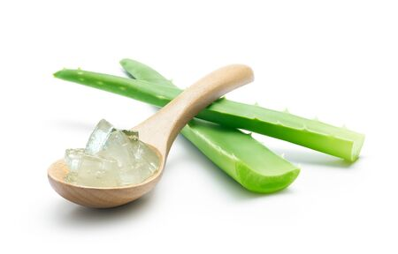 Aloe vera and aloe vera cubes on wooden spoon isolated over white