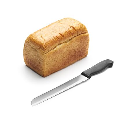 Bread and bread knife on white