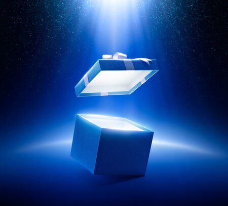 Blue open gift box on glittering background