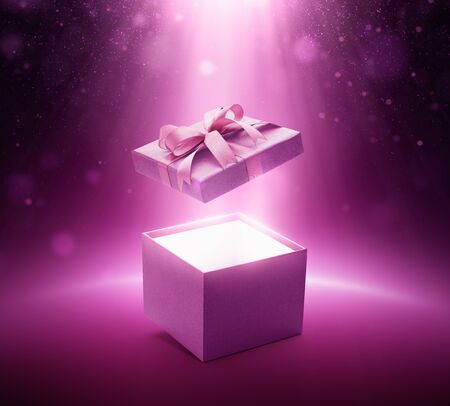 Purple color open gift box with ribbon on glittering background Banco de Imagens