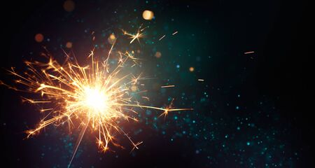 Sparkler on abstract background