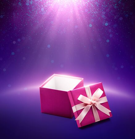 Pink color open gift box on purple glittering background