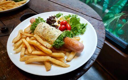 Breakfast - Jumbo sausage wrap with egg, fries, tomato and vegetable  Banco de Imagens