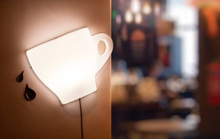 Coffee cup wall light with defocus coffee shop or cafeteria