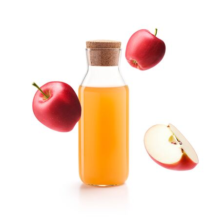 Apple cider vinegar with fresh red apples isolated on white background Banco de Imagens